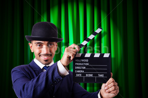 Man with movie clapper on curtain background Stock photo © Elnur