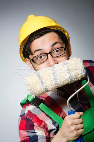 Funny painter with hardhat and roller Stock photo © Elnur