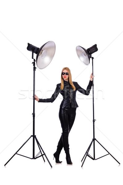Woman in black leather dress in studio shootout Stock photo © Elnur