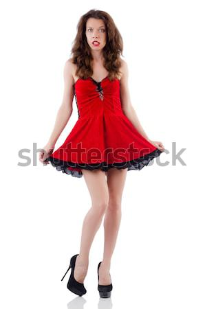Female model posing in red mini dress isolated on white Stock photo © Elnur