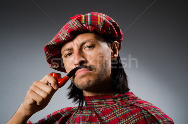 Funny scotsman with smoking pipe Stock photo © Elnur