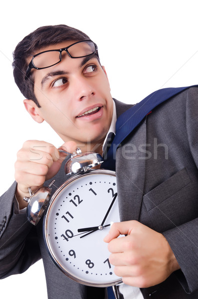 Stock photo: Man with clock afraid to miss deadline isolated on white