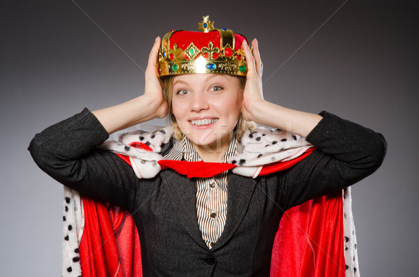 Businesslady wearing crown against gray Stock photo © Elnur