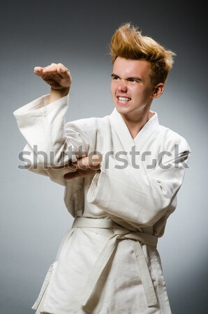 Funny karate fighter with nunchucks Stock photo © Elnur