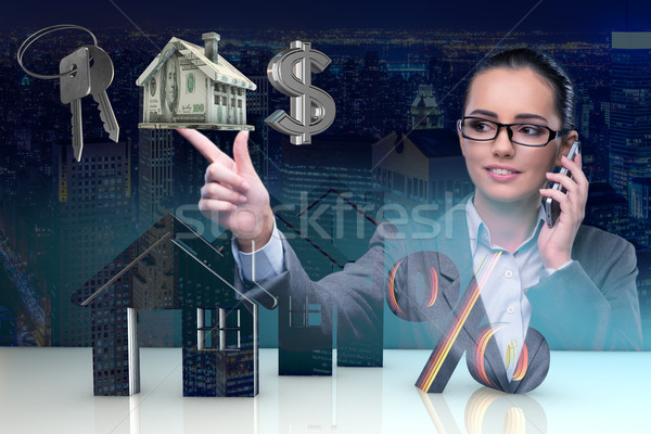 Stock photo: Businesswoman talking on mobile phone in mortgage concept