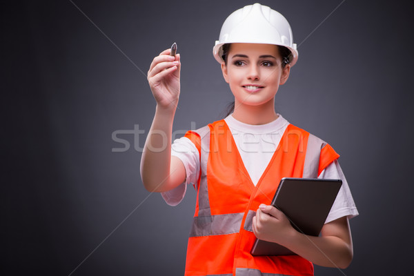 Jonge bouwvakker vrouw oranje werknemer Stockfoto © Elnur