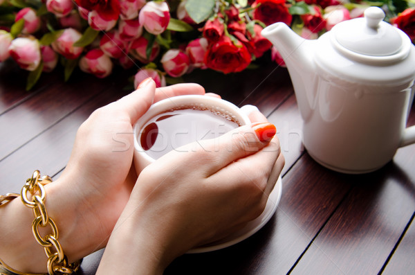Csésze tea vendéglátás virágok kezek üveg Stock fotó © Elnur