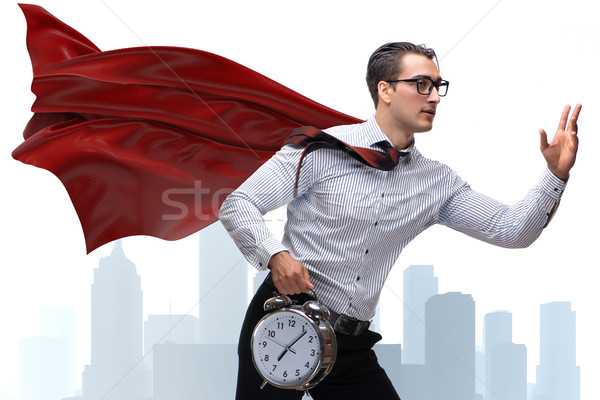 Businessman with red cover and alarm clock Stock photo © Elnur