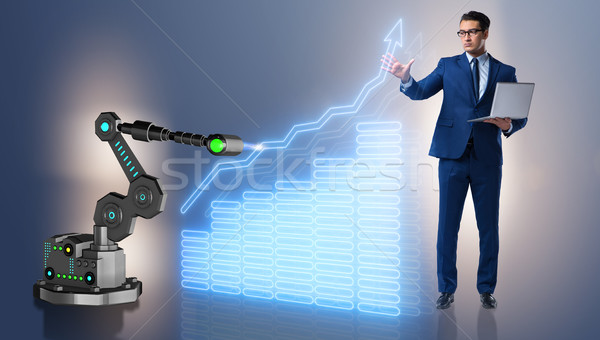 Businessman in business concept with robotic arm Stock photo © Elnur