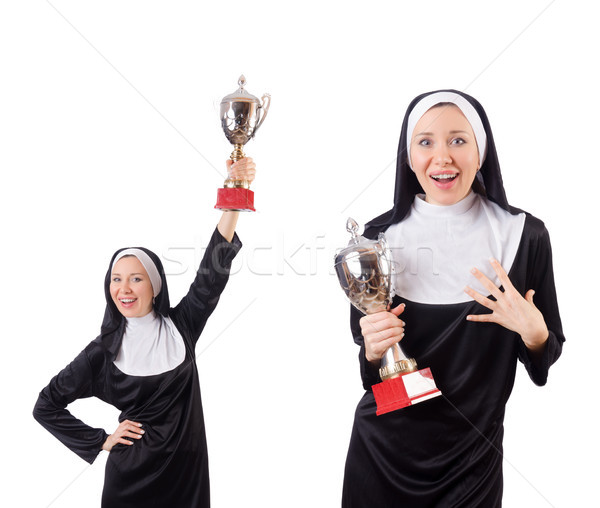 Pretty nun holding winner cup isolated on white Stock photo © Elnur