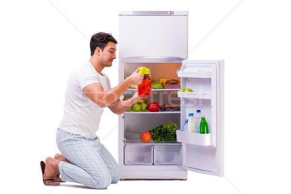 Сток-фото: человека · холодильник · полный · продовольствие · дома · здоровья