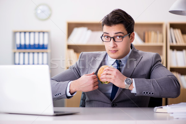 Stock photo: Hungry funny businessman eating junk food sandwich