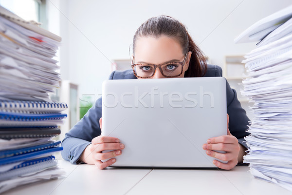 Tired businesswoman with paperwork workload Stock photo © Elnur