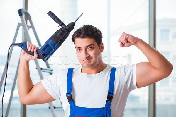 Young worker with hand drill Stock photo © Elnur