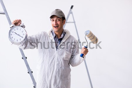 Young repairman with a welding gun electrode and a helmet isolat Stock photo © Elnur