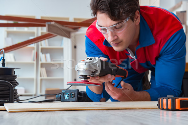 Young carpenter working with wooden planks Stock photo © Elnur