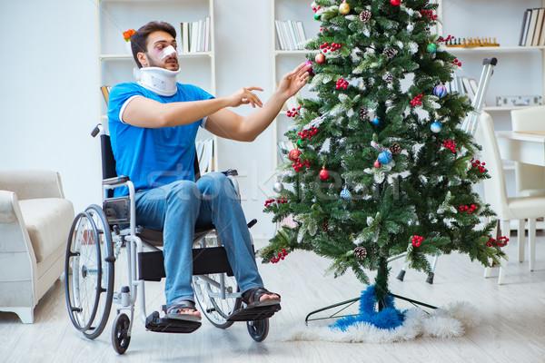 Sebesült mozgássérült férfi ünnepel karácsony otthon Stock fotó © Elnur