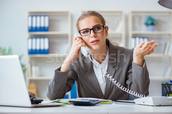 Young businesswoman accountant working in the office Stock photo © Elnur