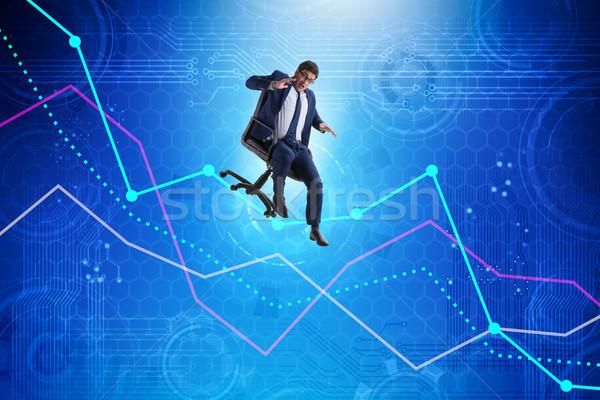 Businessman sliding down on chair in economic crisis concept Stock photo © Elnur