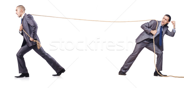 Man in tug of war concept on white Stock photo © Elnur