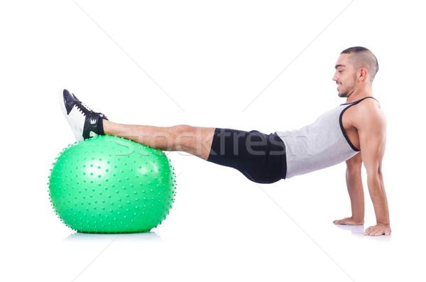Man with swiss ball doing exercises on white Stock photo © Elnur