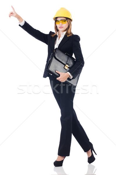 Pretty businesswoman with hard hat and portfolio pressing virtua Stock photo © Elnur