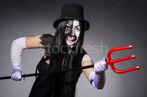 Satana woman with pitchfork and facemask Stock photo © Elnur