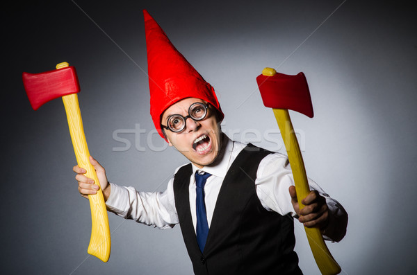 Man with axes in funny concept Stock photo © Elnur