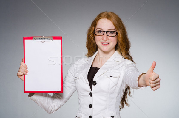 Businesswoman in business concept  with book Stock photo © Elnur