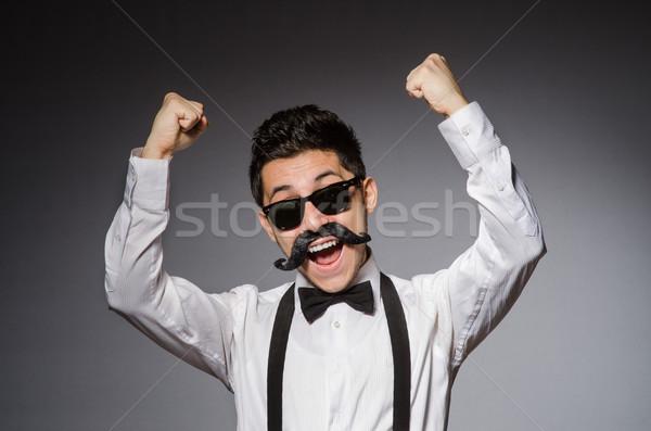 Młody człowiek fałszywy wąsy odizolowany szary model Zdjęcia stock © Elnur