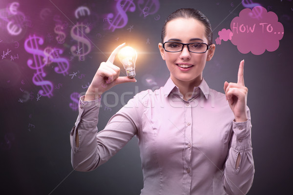 Woman in business concept with lightbulb Stock photo © Elnur
