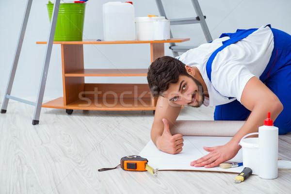 Man doing wallpaper refurbishment at home Stock photo © Elnur