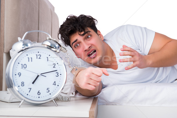 ストックフォト: 男 · ベッド · 不眠症 · クロック · 睡眠