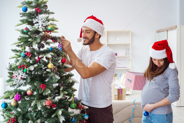 Young family expecting child baby celebrating christmas Stock photo © Elnur