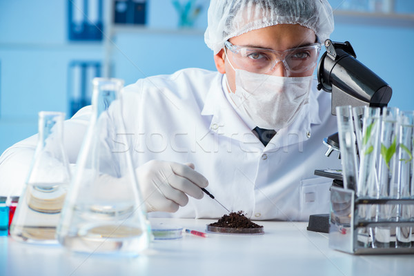 Male scientist researcher doing experiment in a laboratory Stock photo © Elnur