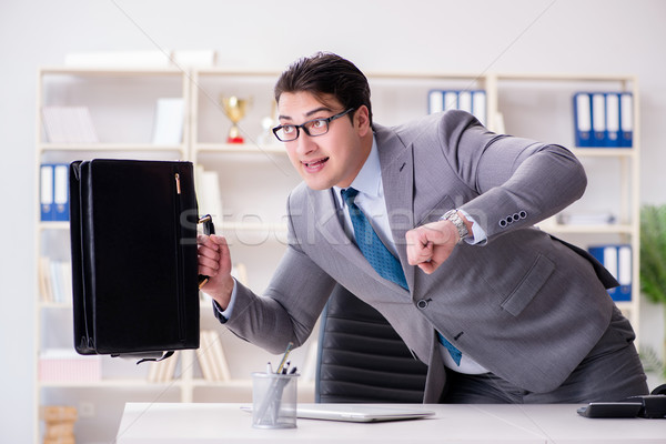 Businessman rushing in the office Stock photo © Elnur