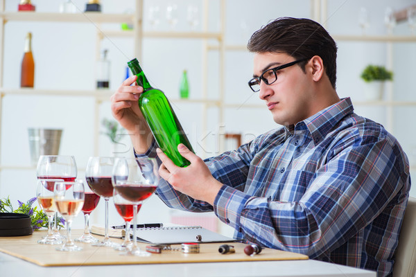 Professional sommelier tasting red wine  Stock photo © Elnur