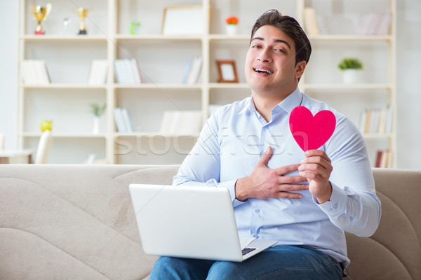 Young man making marriage proposal over internet laptop Stock photo © Elnur