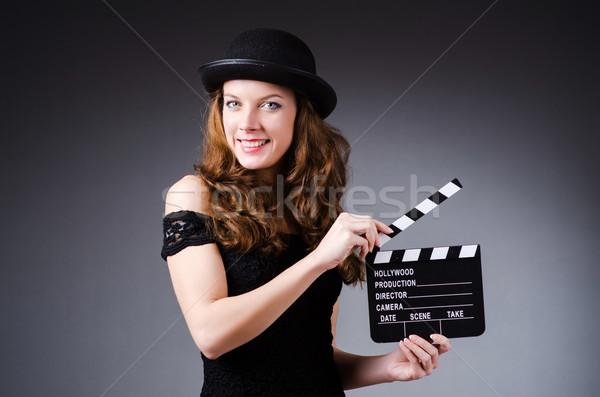 Kobieta film pokładzie strony film piękna Zdjęcia stock © Elnur