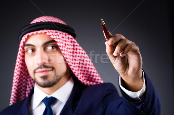 Arab man pressing virtual buttons Stock photo © Elnur