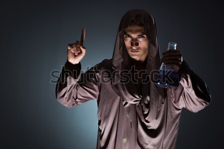 Soldier with guns against dark background Stock photo © Elnur