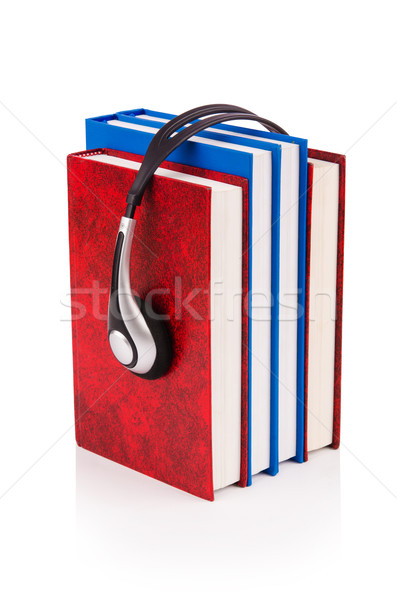 Concept of audio books with earphones on white Stock photo © Elnur