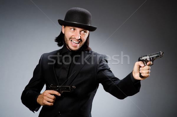 Man wearing vintage hat with gun Stock photo © Elnur