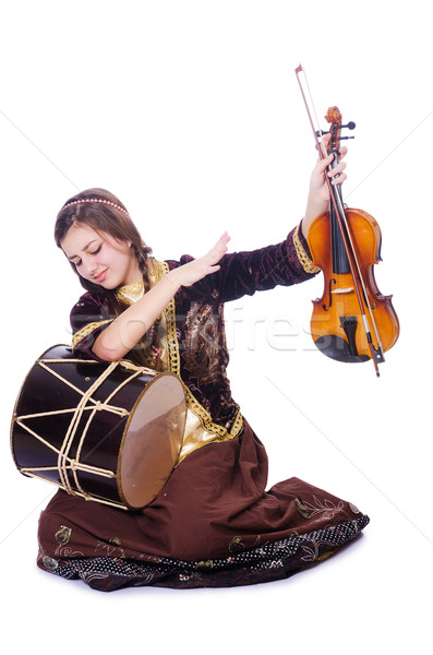 Young woman playing musical instruments on white Stock photo © Elnur