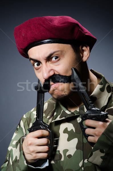 Funny soldier against the dark background Stock photo © Elnur