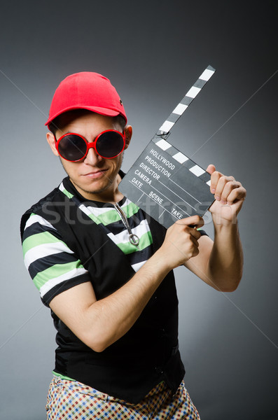 Man with baseball cap and movie board Stock photo © Elnur