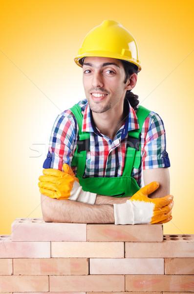 építész védősisak fehér férfi építkezés háttér Stock fotó © Elnur