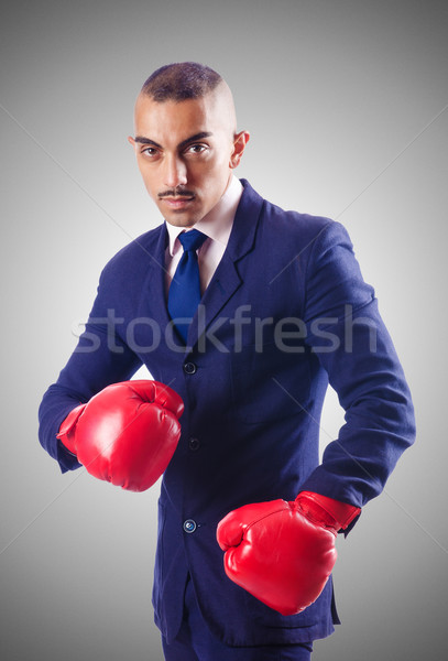 Handsome businessman with boxing gloves Stock photo © Elnur