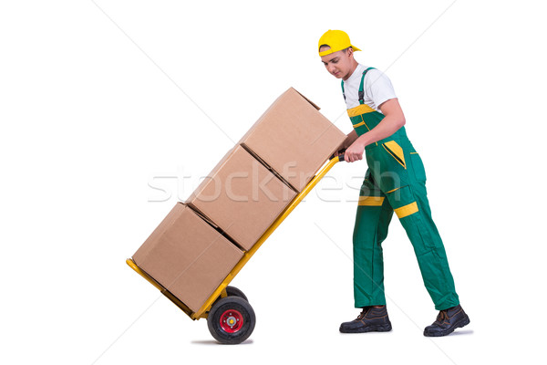 Young man moving boxes with cart isolated on white Stock photo © Elnur