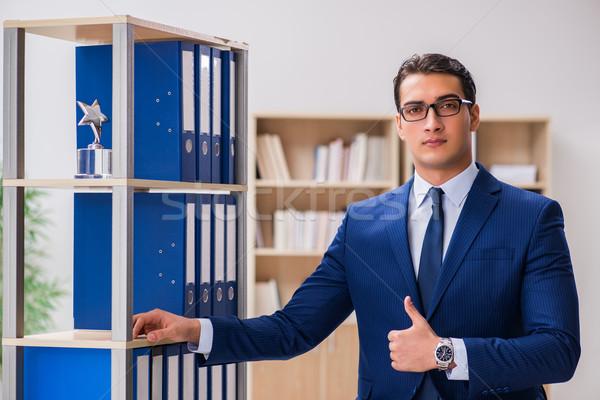 молодым человеком Постоянный шельфа служба бизнесмен Сток-фото © Elnur